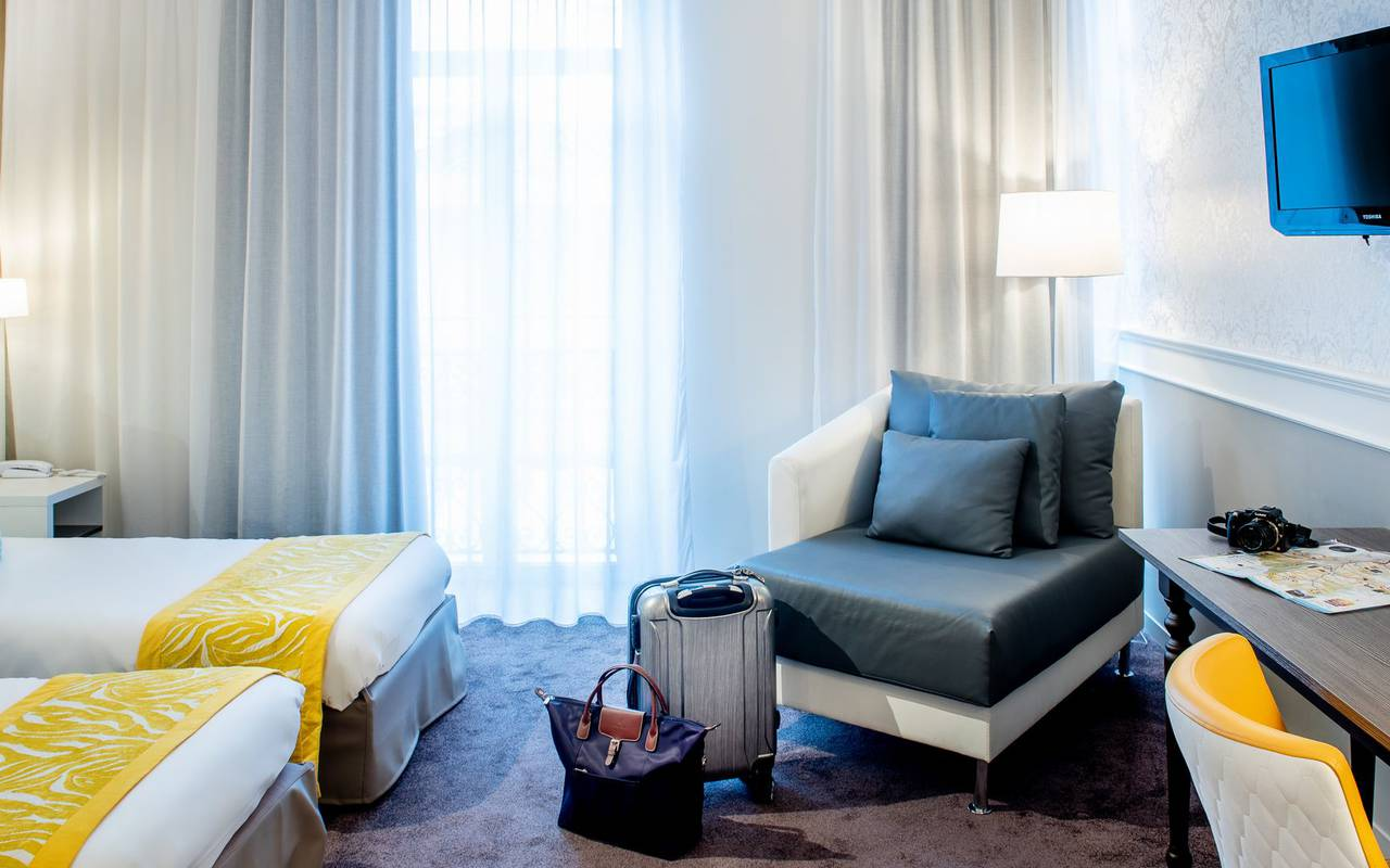 Suitcase in a room, 4-star hotel Lourdes, Hôtel Gallia